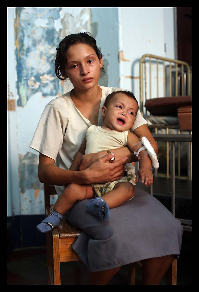 Karen Garcia, 17, and seven-month-old son Richard in the children's ward of the hospital in Ocotal, Nicaragua.
